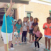 CATHY SPAULDING/Muskogee Phoenix<br /> Oktaha teacher Karen Moore drops a padded egg as participants attending an engineering camp for girls wait to see if it cracks.