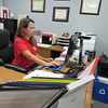 CATHY SPAULDING/Muskogee Phoenix<br /> New Fort Gibson Middle School Principal Carrie Jo Willis checks computer records as she prepares for the start of the school year.