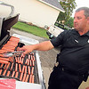 CATHY SPAULDING/Muskogee Phoenix<br /> Fort Gibson Police Chief Donnie Yarbrough cooks hot dogs outside the Frank Gladd American Legion Post 20, where the Fort Gibson National Night Out event was being held.