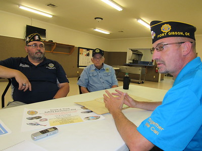 CATHY SPAULDING/Muskogee Phoenix Frank Gladd American Legion Post 20 members, from left, Daniel Gross and Dennis Crittenden, visit with Post Commander Tim Smith. The post celebrates its centennial this month.