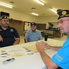 CATHY SPAULDING/Muskogee Phoenix<br /> Frank Gladd American Legion Post 20 members, from left, Daniel Gross and Dennis Crittenden, visit with Post Commander Tim Smith. The post celebrates its centennial this month.