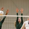 Phoenix special photo by Von Castor<br /> Lady Roughers Ja'Layiah Collins, left, and Madison Wiebe block a shot from Jenks' Ally Stoner Tuesday evening at the MHS volleyball gym.