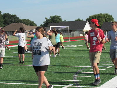 CATHY SPAULDING/Muskogee Phoenix Hilldale High freshman Lauryn Field, left, and senior Gannon Dubin hold their drum mallets during a Wednesday morning practice. They are wrapping up a two-week band camp.