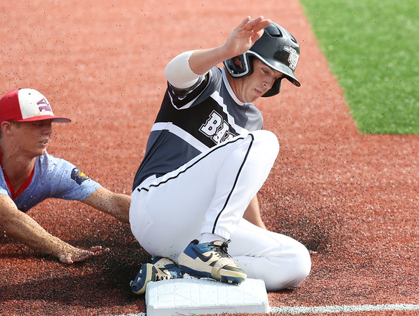 LAURA BEAHM/Courtesy Hastings Tribune<br /> Three Rivers Bandits' Boone Lasater slides into third base beating a tag by Fremont's Dawson Glause in the American Legion Mid-South Regional Tournament Thursday at Duncan Field in Hastings, Neb.
