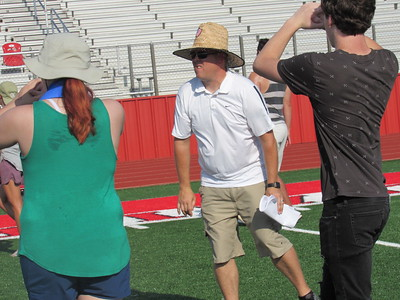CATHY SPAULDING/Muskogee Phoenix Hilldale Band Director Tad Clark walks between two band members during a Wednesday morning field drill. He came to Hilldale after being Eufaula's band director.
