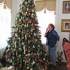 Staff photo by Cathy Spaulding<br /> Lois Gregory inspects one of several Christmas trees in her home, part of the 42nd Annual Christmas Home tour, benefiting the Kelly B. Todd Cerebral Palsy and Neuromuscular Center.
