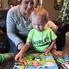 Staff photo by Cathy Spaulding<br /> Christy Biggs helps her grandson, Eli, assemble a puzzle.