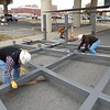 Staff photo by Mark Hughes<br /> Contractors test fit two pieces of the gateway that is set to arch across South Main Street near the corner of Elgin Avenue. Erection of the structure begins Tuesday morning, said Adam Oglesbee, general contractor. Main Street, between Elgin and Okmulgee avenues will be closed to traffic until 5 p.m. Friday, pending inclement weather, said Kimbra Scott, city spokeswoman.