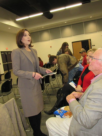 Staff photo by Cathy Spaulding<br /> State Superintendent of Public Instruction Joy Hofmeister, left, visits with Oklahoma School for the Blind Superintendent Rita Echelle and State Rep. Ed Cannaday before a town hall meeting Monday in Muskogee.