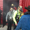 Staff photo by Mark Hughes<br /> Basic firefighter applicants leave a smoke-filled building as part of their testing to become a member of Muskogee's Fire Department. About 49 candidates arrived for the agility test, and by the end of the day only 18 made it. There are four basic firefighters position open.