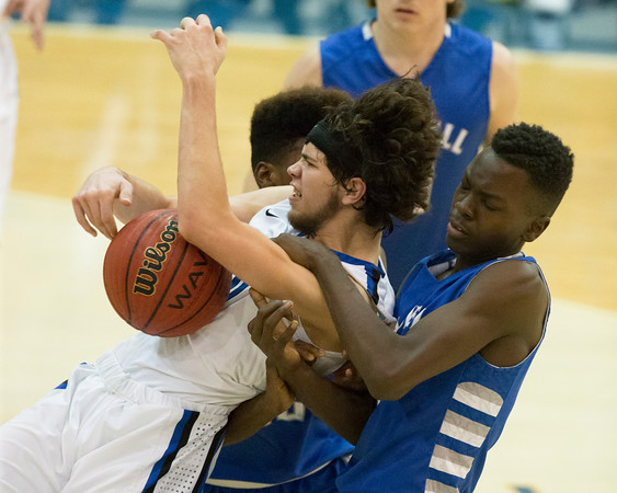 Phoenix special photo by Von Castor<br /> Checotah's Kaleb King, left, and Haskell's Darrell McJunkins battle for a rebound during Tuesday's game in Checotah.