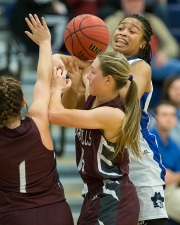 Phoenix special photo by Von Castor<br /> Porter's Cheyenne Marshall is fouled in the lane by Webbers Falls' Shianne Garrison Thursday night at Pirate Field House in Porter.