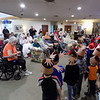 Special photo by Mike Elswick<br /> About 100 Muskogee Early Childhood Center preschool students on Friday morning stopped by Eastgate Village to entertain residents with Christmas carols, pass out cards and leave gifts.