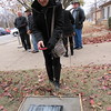 Staff photo by Cathy Spaulding<br /> Sharon Boling, Central High School Class of 1963, shoots a picture of a stone marker showing where the school building once stood. The site is now Fair Haven Senior Residences.