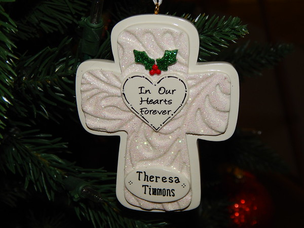 Staff photo by Mark Hughes<br /> A Christmas ornament commemorating the 1988 death of Theresa Timmons hangs from the Tree of Remembrance that is located at Arrowhead Mall near Kenneth Lee Designs. The tree's lighting is a 6:30 p.m. Dec. 19.