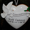 "Staff photo by Mark Hughes<br /> A ""we remember"" Christmas ornament celebrating the life and death of Scott Cannon, adorns the tree."