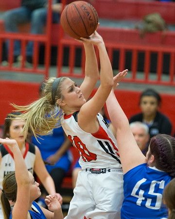 Phoenix special photo by Von Castor<br /> Hilldale's Lacey Bell knocks down a shot in the lane early in the second quarter as Checotah's Jaycee Buckmaster, right, defends Friday night at the Hilldale Event Center. Bell and the Lady Hornets won 79-38.
