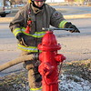 Staff photo by Cathy Spaulding<br /> Warner Fire Explorer Post 601 member Stevana Marshall tightens a fire hydrant after post members demonstrated how quickly they can prepare fire hoses Tuesday.