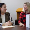 Special photo by Mike Elswick<br /> Lindsey Roberts, right, discusses details of prescription drug lock boxes with Jenny Crosby, training and outreach specialist for CASA. The boxes are available free from the Region 15 Regional Prevention Program at 207 N. Second St., or by calling (918) 683-4600.