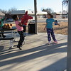 Staff photo by Cathy Spaulding<br /> Keirra Ellison, 7, tries out her new in-line skates while waiting to catch a new Five Nights at Freddy's stuffed animal from Chenoa Jenkins, 9, on Tuesday at King Park.