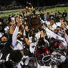 Phoenix special photo by Von Castor<br /> Wagoner Bulldogs football team huddles around reaching for their trophy as they celebrate their third straight Class 4A championship win. For a complete recap of the game, see the story on Page 1B