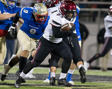 Phoenix special photo by Von Castor Wagoner's Marvin Trotter, right, runs by Oologah's Brock Martin during the second quarter of Friday's Class 4A championship game in Broken Arrow.