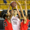 Phoenix special photo by Von Castor<br /> Sequoyah's Tyeus Daugherty, center, is fouled in the lane during the Indians' 74-70 overtime loss to Tulsa Central in the consolation semifinals on Thursday in the Tournament of Champions at the ORU Mabee Center in Tulsa.