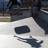 Staff photo by Cathy Spaulding<br /> Cade Richards, 12, of Fort Gibson casts a shadow while leaping and skateboarding at the Fort Gibson skate park Thursday. A friend watches. The area experienced plenty of sunshine and cool temperatures Thursday. The mildness is expected to continue until Monday, when storms are expected, according to AccuWeather.