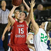 Phoenix special photo by Von Castor<br /> Fort Gibson's Zoe Shieldnight scores over Adair's Rylie Looney Thursday during the semifinals on Thursday of the Tournament of Champions at the ORU Mabee Center in Tulsa.