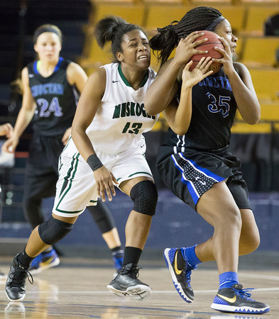 Special photo by Von Castor<br /> Muskogee's Zomaree McNac, left, tries for the steal against Choctaw's Zahria White in the girls championship game of the Tournament of Champions on Wednesday at the Mabee Center at Oral Roberts University.