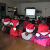 Staff photo by Cathy Spaulding<br /> Second-graders in Santa hats join other St. Joseph Catholic School students at a Monday presentation about the many things made from petroleum, as well as the dangers of playing around oil tanks.
