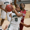 Phoenix special photo by Von Castor<br /> Muskogee's Trena Mims fights through the Owasso defense to score during Tuesday's game at Ron Milam Gymnasium. The Lady Roughers lost 49-39.