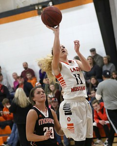 Phoenix special photo by John Hasler Okay's Kyndra Whiteday, right, stops for a jump shot in front of Morris' Emily Wiedel during Tuesday's game in Okay.