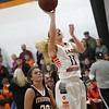 Phoenix special photo by John Hasler<br /> Okay's Kyndra Whiteday, right, stops for a jump shot in front of Morris' Emily Wiedel during Tuesday's game in Okay.