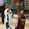 Phoenix special photo by Von Castor<br /> Muskogee's Tyreece Berry, left, scores one of his two baskets in overtime ahead as Owasso's Josh Proctor defends Tuesday at Ron Milam Gymnasium. The Roughers beat the Rams 65-64.