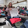 Staff photo by Cathy Spaulding<br /> Warner High School student Jalynn Duncan folds<br /> clothes for the school's Christmas charitable program.<br /> The school also plans a Christmas Festival next Wednesday.