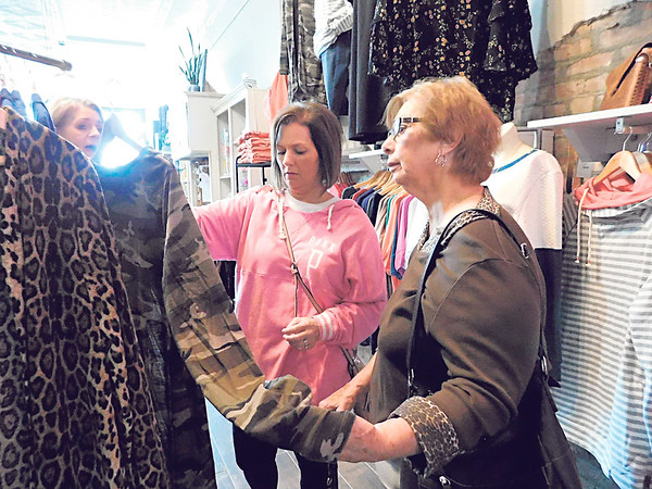 """KENTON BROOKS/Muskogee Phoenix<br /> Lee Ann Gibson, left, and her mother Shirley Finch shop at The Festive Nest during Small Business Saturday. Gibson said she prefers """"the boutique shops because you can get more unique items."""" The day is an American shopping holiday held annually two days after Thanksgiving."""