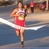 Phoenix special photo by John Hasler<br /> Jess Mandalen of Bacone College crosses the line in 16 minutes, 24 seconds to win the men's portion of the Garden of Lights 5K run at Honor Heights Park.