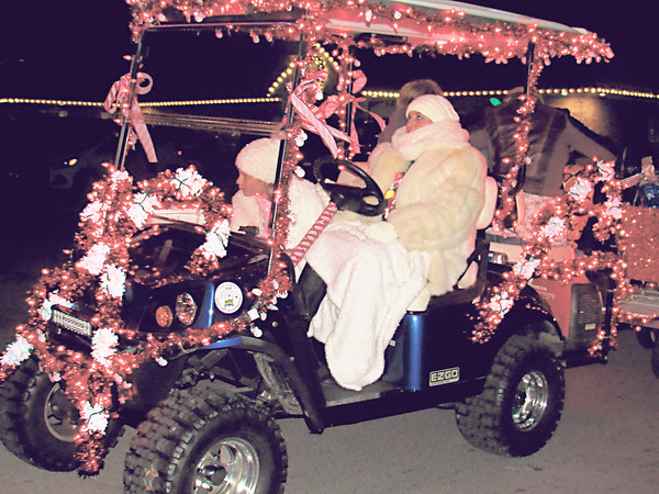 CATHY SPAULDING/Muskogee Phoenix<br /> Fort Gibson Christmas parade participants bundled up like polar bears against Monday night's cold temperatures.