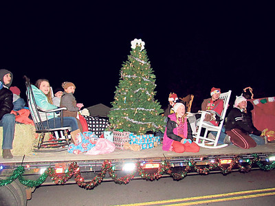 """CATHY SPAULDING/Muskogee Phoenix """"4-H Club members add their interpretation of Rockin' Around the Christmas Tree"""" with their float in the Fort Gibson Christmas Parade. Scores of people came out to the Fort Gibson Christmas Parade, Rockin' Around the Christmas Tree,"""" on Dec. 3. Several groups served cocoa, coffee and cookies."""