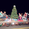 "CATHY SPAULDING/Muskogee Phoenix<br /> ""4-H Club members add their interpretation of Rockin' Around the Christmas Tree"" with their float in the Fort Gibson Christmas Parade. Scores of people came out to the Fort Gibson Christmas Parade, Rockin' Around the Christmas Tree,"" on Dec. 3. Several groups served cocoa, coffee and cookies."