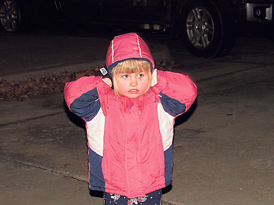 Brooklyn Coombes, 4, shields her ears from sirens and motor noises.