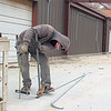 CATHY SPAULDING/Muskogee Phoenix<br /> David Williams of Williams Electric adjusts the metal pipe to cover electric lines inside the Fort Gibson Public Schools agriculture building extension.