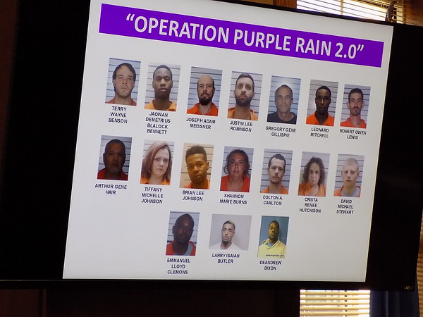 Staff photo by Mike Elswick<br /> A graphic prepared by the Muskogee County District Attorney's Office was shown during a Monday press conference with arrest mug shots of some of 32 people arrested in a warrant sweep conducted last week by multiple law enforcement agencies.