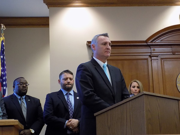 "Staff photo by Mike Elswick Muskogee County District Attorney Orvil Loge addresses a press conference Monday afternoon. He is surrounded by law enforcement representatives from several agencies involved in ""Operation Purple Rain 2.0"" resulting in the arrests."