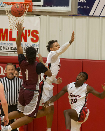 Phoenix special photo by Von Castor<br /> Hilldale's Devon Hembry, center, and Tre Mitchell, right, try to block the shot of Sequoyah's Bobby Cade during Tuesday's game at the Hilldale Event Center.