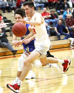 Phoenix special photo by John Hasler Fort Gibson's Carson Calavan drives past the Oologah defense and to the basket on Tuesday.