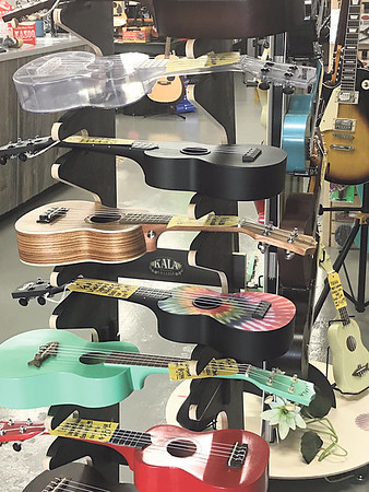ANDREA CHANCELLOR/Special to the Phoenix<br /> A colorful ukulele display invites students to try one out.