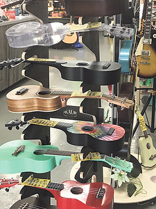 ANDREA CHANCELLOR/Special to the Phoenix A colorful ukulele display invites students to try one out.