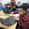 CATHY SPAULDING/Muskogee Phoenix<br /> New Tech at Cherokee Elementary fifth-graders, from left, Joshua Jimerson, Daquan Jones and Marcus White use laptops to work on projects. Cherokee is incorporating project-based learning in its program this year.